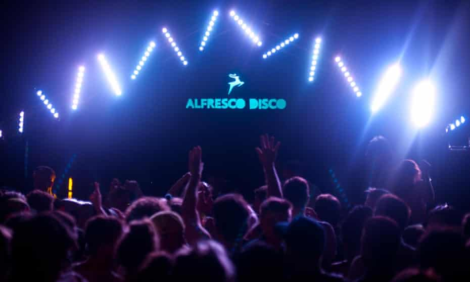 Revellers at an indoor music event hosted by Alfresco Disco, based in Bristol, UK
