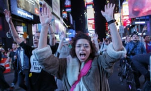 Demonstrators protest on Times Square in New York after the announcement of the grand jury decision