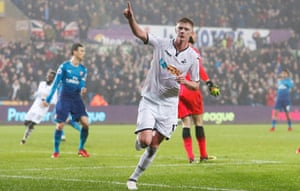 Sam Clucas celebrates after scoring the first of his two goals in Swansea's win at home to Arsenal.