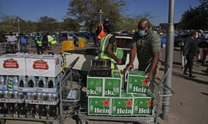 Workers help a customer load alcohol in his van moments after purchasing at Makro Silverlakes Liquor Store in Pretoria on June 1, 2020.