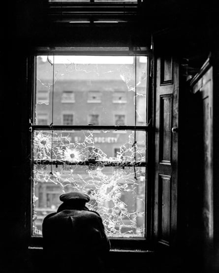 A soldier looks out a window shattered by bullets in Dublin in July 1922.