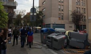 These bins have been used as barricades outside a school in the centre of Girona.