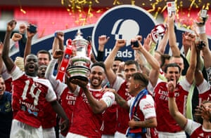Arsenal's Pierre-Emerick Aubameyang (centre) and teammates celebrate with the trophy.
