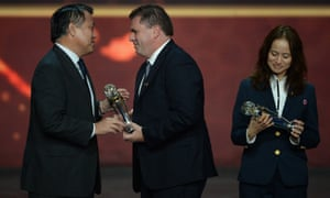 Ange Postecoglou collected his coach of the year award at the gala evening in India, while Japan's Asako Takakura won the women's equivalent.