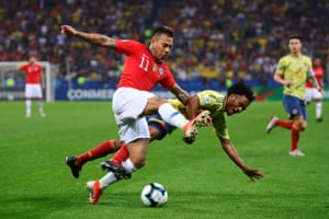 Eduardo Vargas of Chile and Juan Cuadrado of Colombia battle for possession during the 0-0 draw before going to penalties.