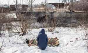 Nadiya Volkova, 24, grieves for her mother Katya Volkova, 60, killed by shelling.