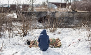 A woman grieves over the body of her mother who was killed by shelling in Avdiivka, Ukraine