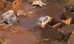 Cars and homes were destroyed after an iron mine dam burst in Minas Gerais state.