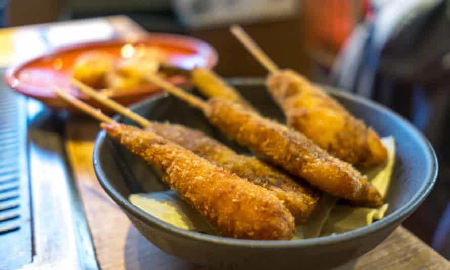 kushikatsu is breaded fried things on sticks.