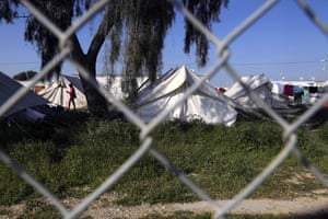 A migrant walks by the tents inside a refugee camp in Kokkinotrimithia outside of Nicosia, Cyprus, in this picture taken last Tuesday