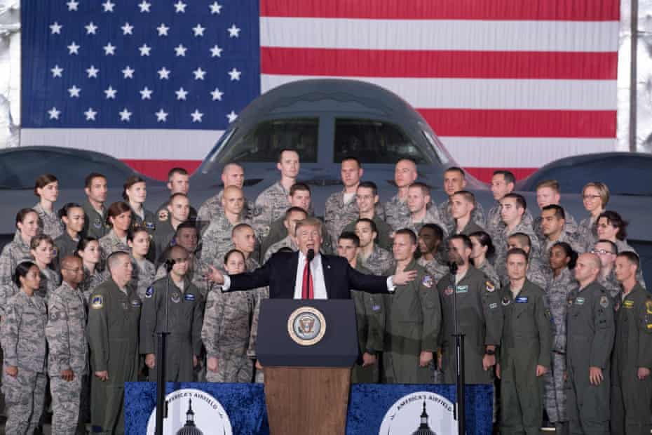 Donald Trump delivers remarks in front of military personnel and a B-2 Spirit aircraft inside a hangar at Joint Base Andrews, Maryland, on 15 September 2017.