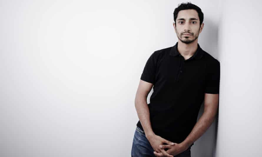 riz ahmed posing for a photograph