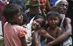 Muslim Rohingyas in Ghumdhum, Cox's Bazar weep as Bangladesh border guards order them to leave their makeshift camp and the country in August 2017.