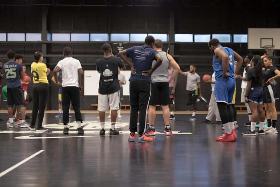 Basketball players being coached at the Regal, Kennington, south London