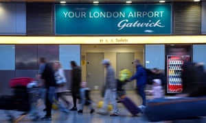 Passengers walk through the South Terminal building at Gatwick Airport