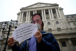 A protester wearing a mask of BoE head Andrew Bailey.