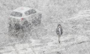 A pedestrian braves the weather during a spring snowstorm in Moscow, Russia
