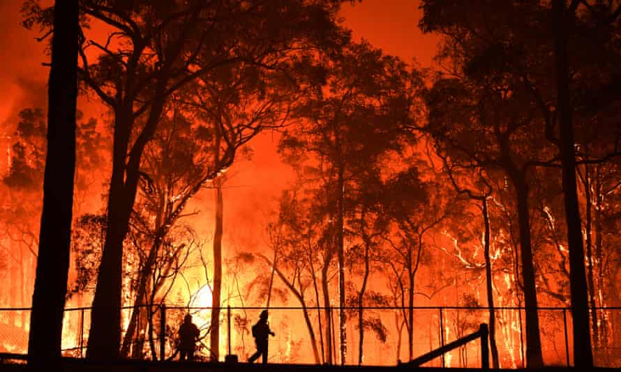 RFS volunteers and NSW Fire and Rescue officers at the Gospers Mountain fire 19 November 2019.