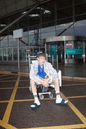 Shorts, £319, Boss by Hugo Boss (hugoboss.com). Jacket, £350, Hugo by Hugo Boss (hugoboss.com). Shirt, £25, from Beyond Retro (beyondretro.com). Sliders, £195, by Jimmy Choo (jimmychoo.com). Socks, £3.50, by Topman (topman.com).