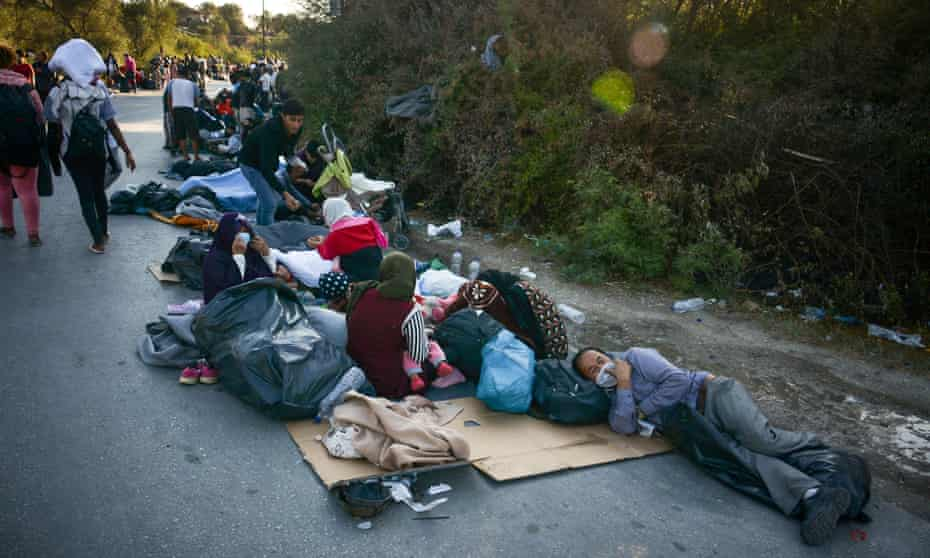 Homeless refugees camp on a road in Lesbos, after Moria camp was ravaged by fire.