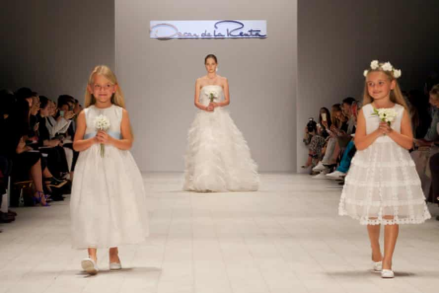 Beaming flower girls accompanying the bride down the runway at the finale of the show.