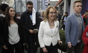 Gabby Giffords, center, walks with Golden State Warriors' Klay Thompson, second from left, during a peace march.