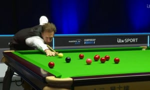 Judd Trump takes on a pot during his 3-0 group win over David Grace at Marshall Arena.