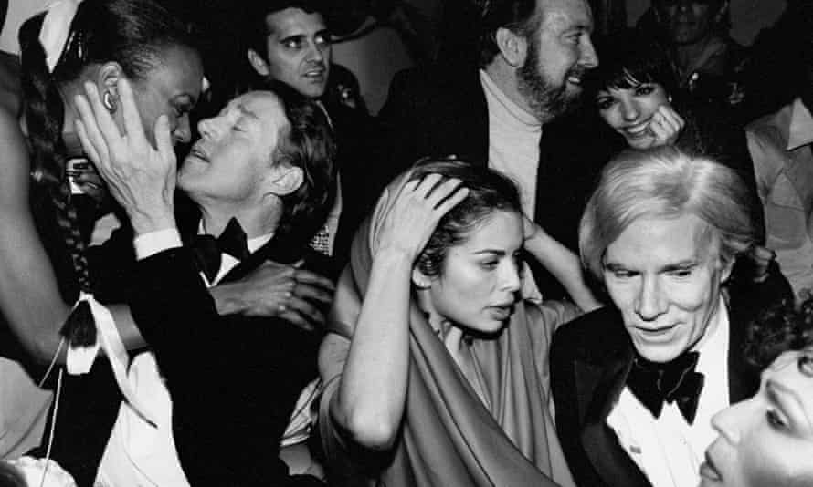 Bianca Jagger, Liza Minnelli and Andy Warhol at a New Year's Eve party at Studio 54