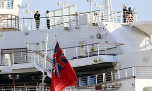People stand on the deck of the quarantined Diamond Princess