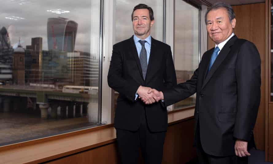 Nikkei's Tsuneo Kita greeted by the FT's chief executive, John Ridding.