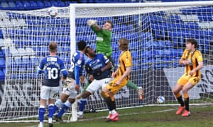 Oldham keeper Laurie punches Luke Hannant's corner into the net for Cambridge United's fourth goal.
