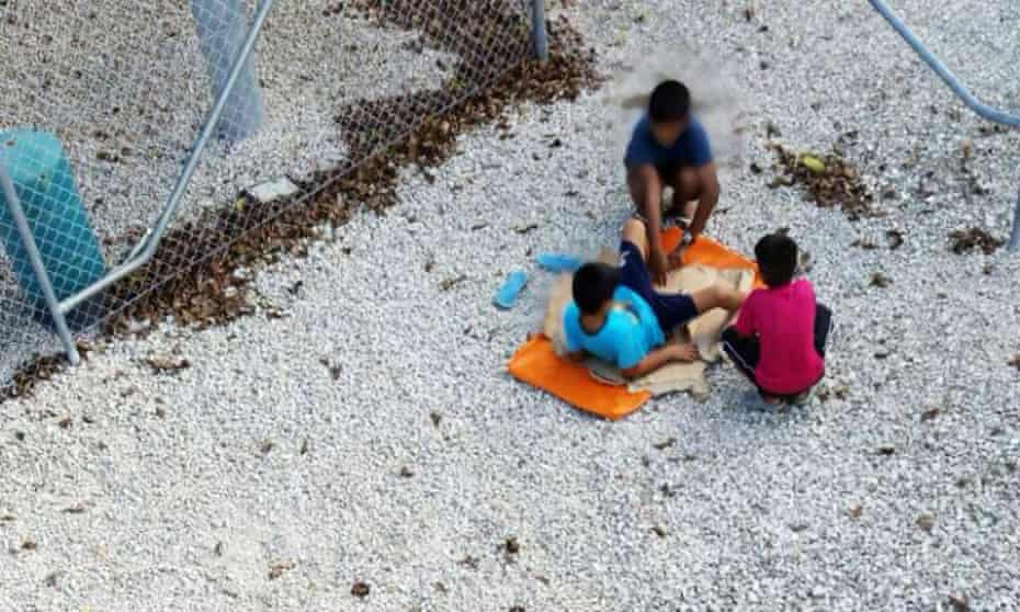 Amnesty image claiming to show children playing near a fence at the Australian-run detention centre on Nauru.