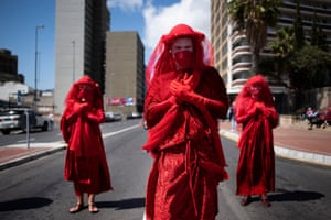 The Red Rebels performance group join hundreds of people taking part in a global climate protest in Cape Town, South Africa