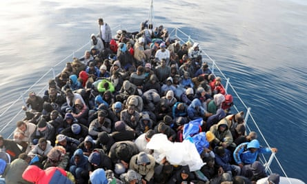 Migrants are rescued from overcrowded boats in the Mediterranean Sea by Libyan coast guards