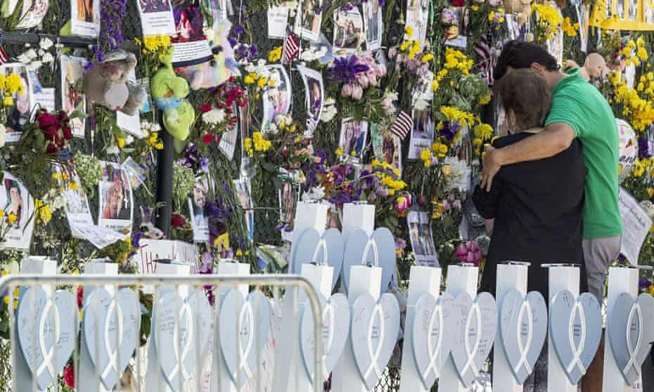 People pay their respects to the victims of the Champlain Towers South collapse, in Surfside, Florida.