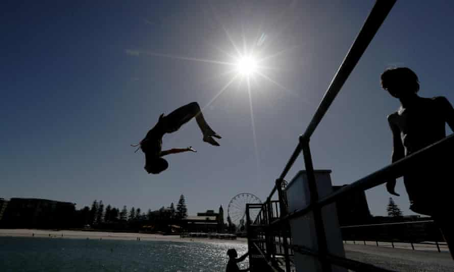 People in Adelaide head to the beach to escape Thursday's record-breaking Australia heatwave.