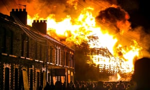 A towering bonfire lights up the sky in Chobham Street, east Belfast, on Saturday night as part of the loyalist celebrations marking William of Orange's victory over James II at the Battle of the Boyne in 1690. Nearby houses were evacuated