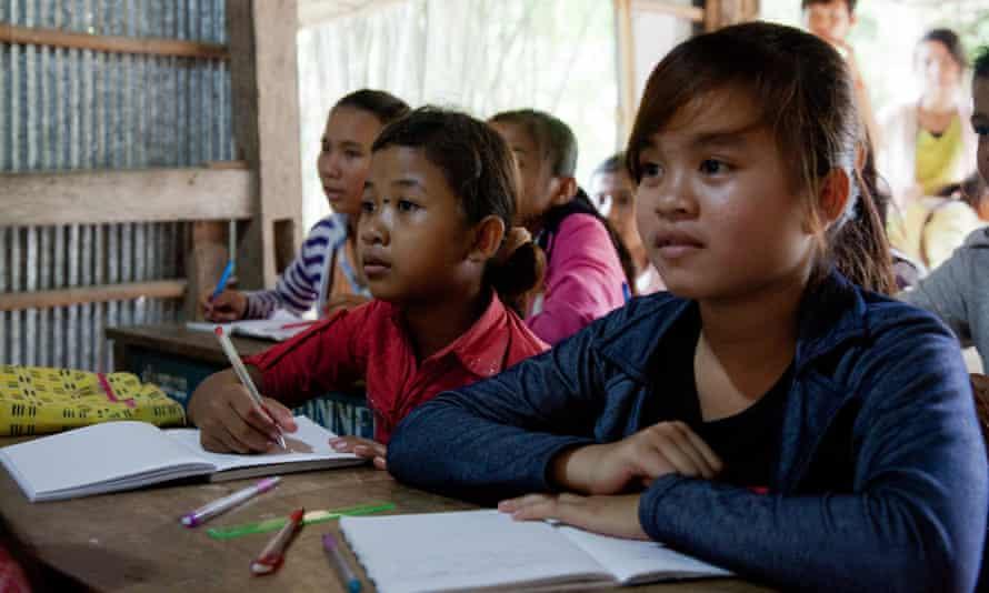 Girls learn English in a small school in Cambodia