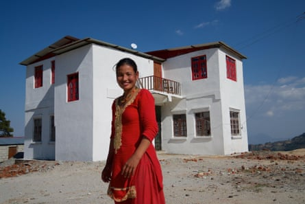 Ranjana Tamang, 27, in front of the local administrative office, which she helped to build after being trained as a mason
