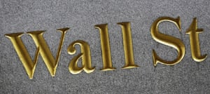 A sign for Wall Street carved into the side of a building in New York.