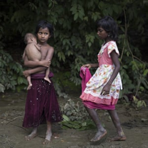 Rohingya refugee children gather by the side of the road in Kutupalong, Bangladesh