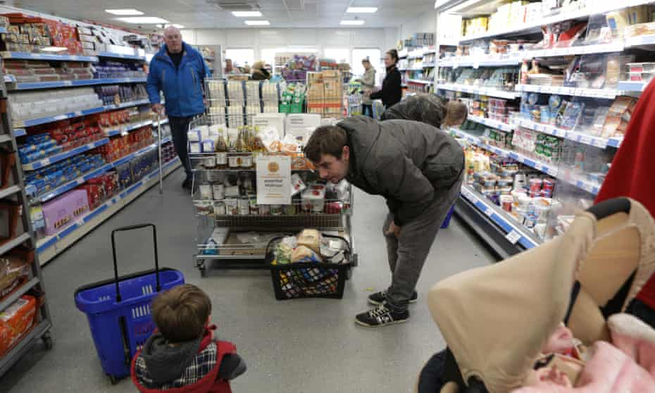 Customers at the Community Shop, in Athersley, South Yorkshire.