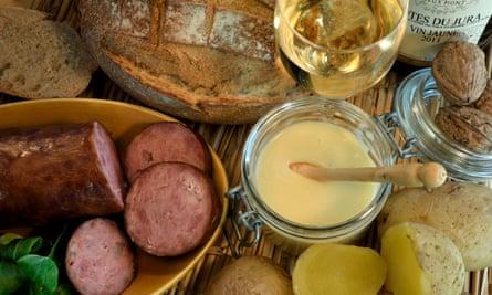 Franche-Comté specialties including cancoillotte cheese and saucisse de Morteau.