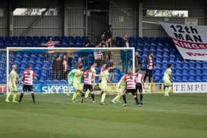 Supporters reclaim their old stand during the match.