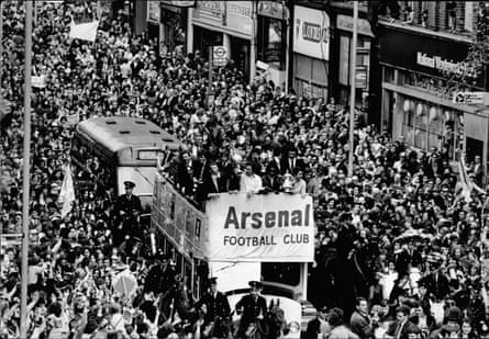 Arsenal players take the Cup to Islington Town Hall.