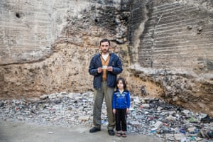 Ahmad Theeb Abu Shefeh, pictured with his daughter, Amani, five, holding his Syrian ID card