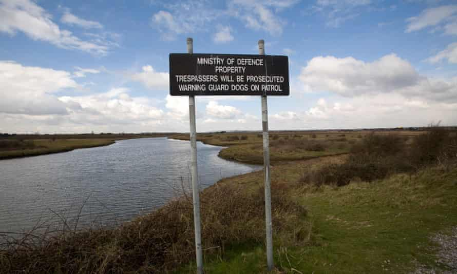 Signs inform walkers they are on MoD land, Thorney Island.