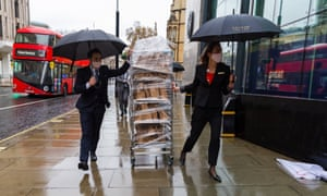Staff from the Conrad Hotel delivering lunch to the venue where the UK-EU trade talks have been taking place in London.