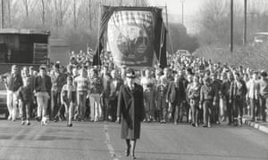 Kellingley Colliery marchers follow a lone policewoman during the 1985 miners strike.
