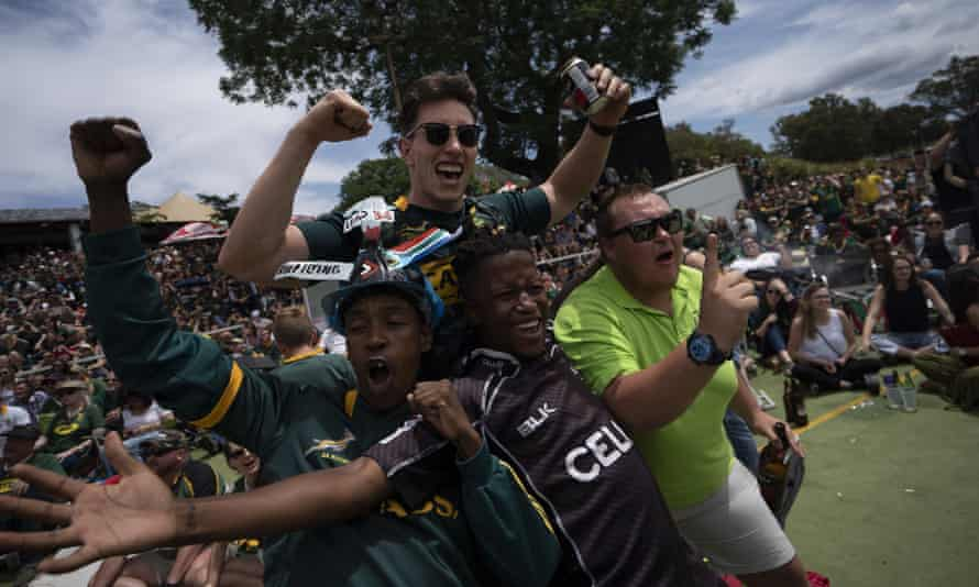 Fans celebrate at the Pirates Rugby Club in Johannesburg